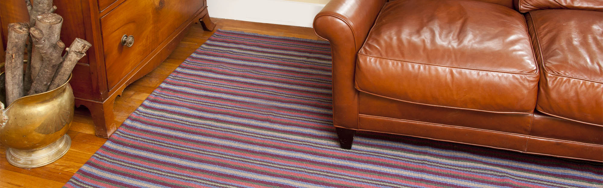 Dalton Stripe Eco Cotton Rug under leather couch