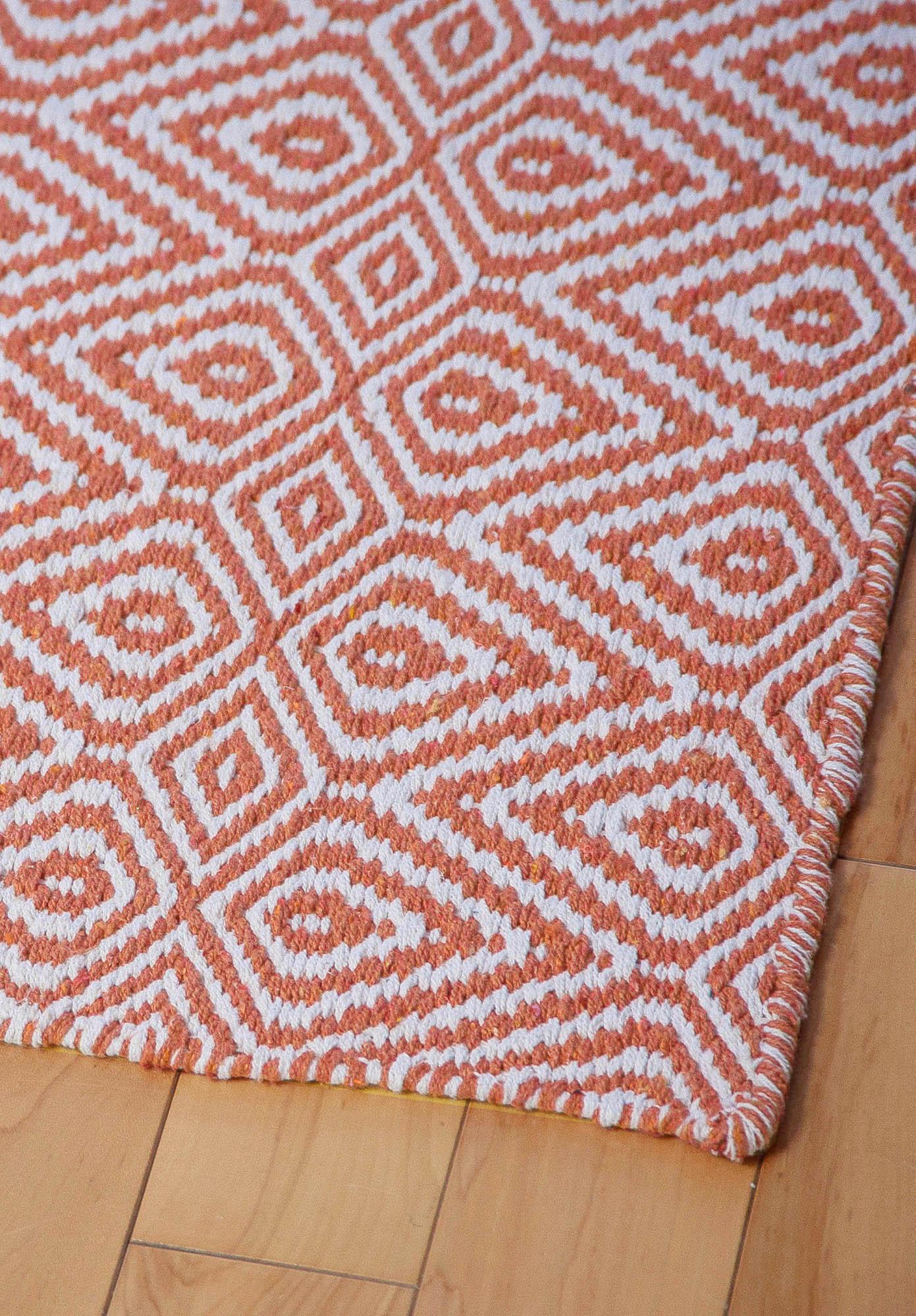 we . wild diamonds eco cotton rug  orangewhite  hook  loom